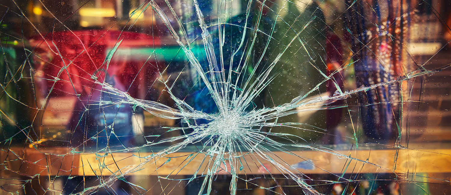 Glass that was hit by flying debris without safety window film